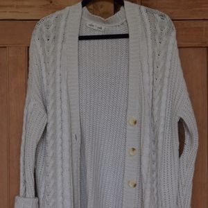 Cream knit cardigan with buttons and elbow patches